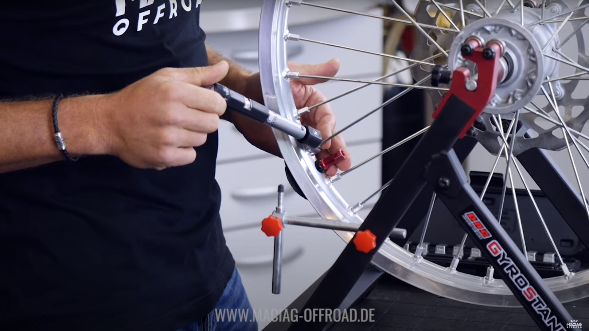 Wheel spoke tension adjustment